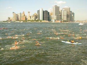 Swimmers braved the current of the Hudson River to swim two miles around Governors Island on Friday.