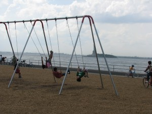Visitors enjoy the swings at Picnic Point