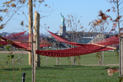 Visitors to Hammock Grove can relax in one of its fifty hammocks, and enjoy spectacular views of the Statue of Liberty and New York Harbor. Photo: Timothy Schenck Photography courtesy of The Trust for Governors Island.