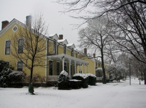 The snow covered porches and brick paths of Nolan Park.