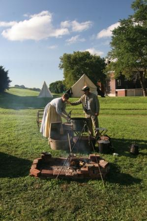 Civil War era living historians prepare for a meal on Governors Island. Image by Daniel C. Krebs, courtesy of the NPS.